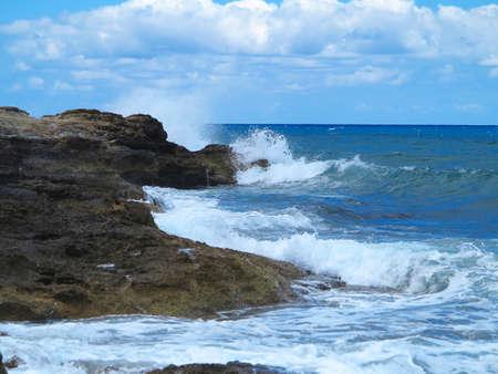 big waves: Big waves on rock coast blue sea and sky on Crete, Greece