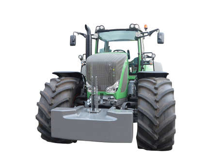 agronomics: New green powerful tractor isolated over white background Stock Photo