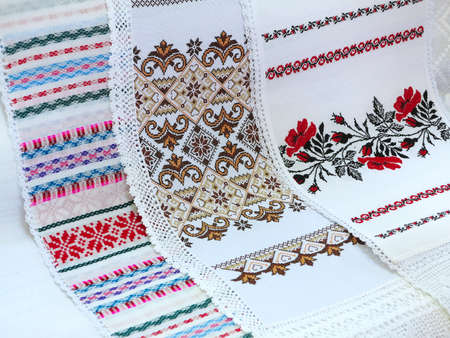 rushnik: Old traditional balkan handmade floral embroidery on white canvas .