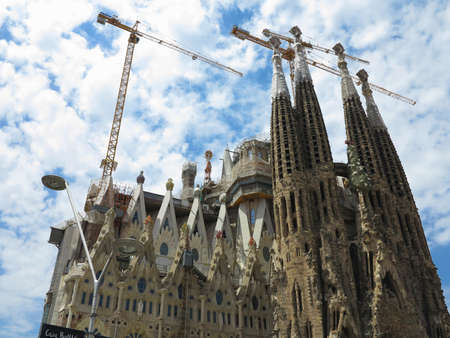 05.07.2016, Barcelona, Spain: Sagrada Familia church under construction with building cranes. Editorial