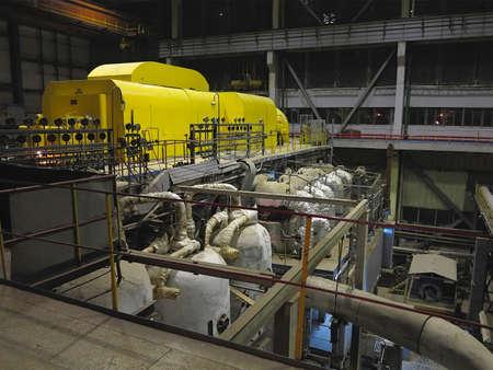 steam turbine: Steam turbine during repair, machinery, pipes, tubes at a power plant, night scene