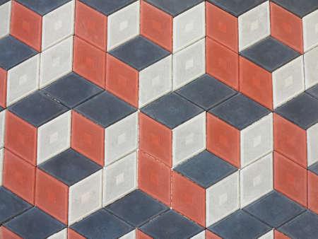 Abstracte geometrische bakstenen stenen trottoir zwart en rood patroon. Stockfoto