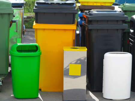 segregate: A  lot of different colorful garbage bin containers.