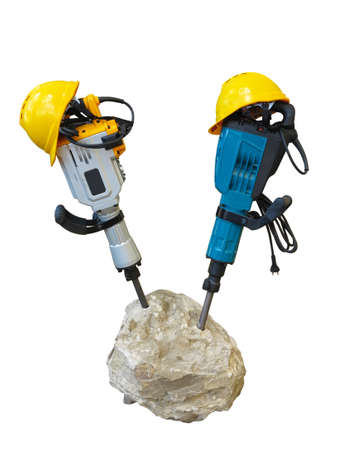 jack tar: construction concept - jackhammer in concrete and yellow helmet isolated over white background Stock Photo