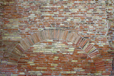Old red brick wall with arch vintage texture background. Stock Photo