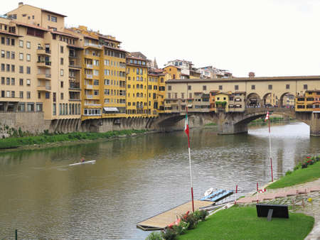 14.06.2017 Florence, Italy: View of medieval stone bridge Ponte Vecchio and the Arno River