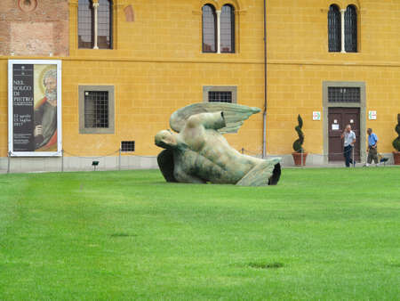 14.06.2017, Pisa, Italy:Statue of fallen angel by Igor Mitoraj on Square of Miracles, Toscana Editorial