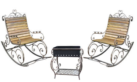 Beautiful forged metall roching chair and barbecue grill isolated on white background Stock Photo