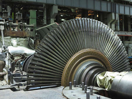 Disassembled steam turbine in the process of repairing an electric generator at a power plant