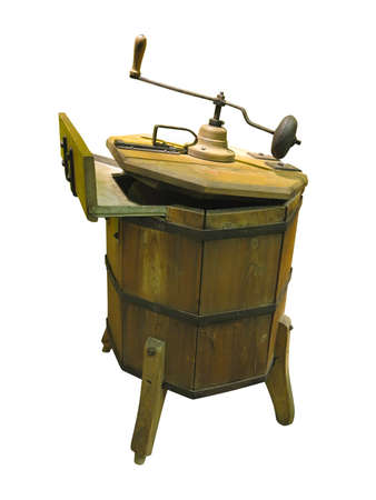 Old wooden hand-held washing machine isolated over white background