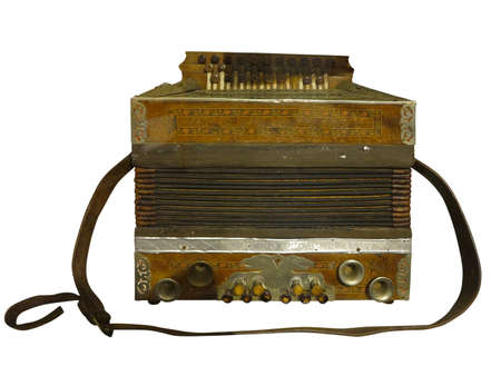 Vintage old brown wooden accordion isolated over white background