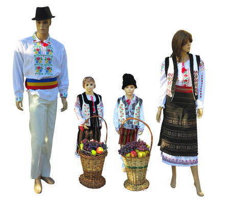 Family Mannequins in national traditional balkanic, moldavian, romanian costumes isolated over white background