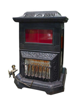 Old vintage burning heater cast iron stove isolated over white background