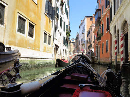 20.06.2017, Venice, Italy: View from gondola to old historic buildings and canals.