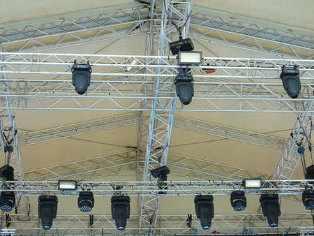 Modern stage metallic structures and light equipment before concert Фото со стока