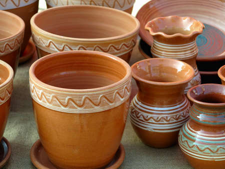 Beautiful handmade clay pots and other dishes sold at the fair shop Banco de Imagens