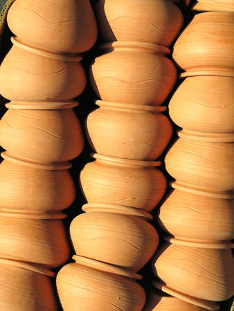 Beautiful brown handmade clay pots sold at the fair shop Stock Photo