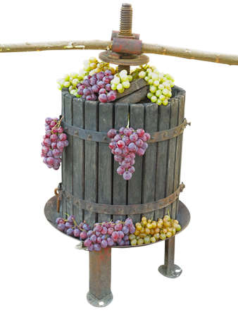 Old traditional manual wine press utensil with grape bunch isolated over white background Banque d'images
