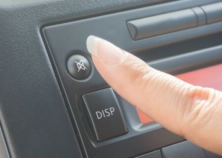 car audio: Press silence button on car audio