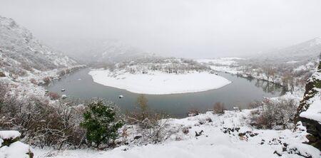 Panoramic view of Arda river in Rodopi Mountains. Kardzali province, Bulgaria, in snowy winter day