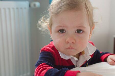 Portrait of a cute little boy crying