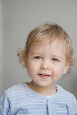 Happy sweet little baby boy portrait on white background