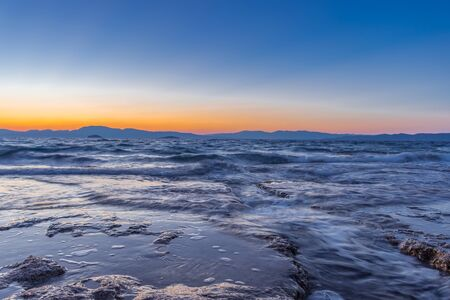 Beautiful sunset at Mediterranean Sea with wild and rocky beaches
