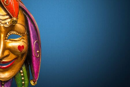 Traditional Venetian mask on the streets of Venice, Italy, isolated on colorful background.