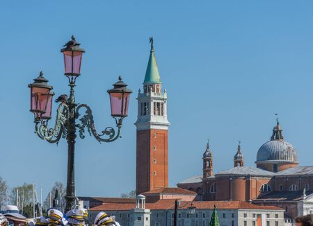 The St. Mark's Square (Piazza San Marco) with column with winged lion and San Giorgio di Maggiore church in the background, in Venice, Italy Imagens