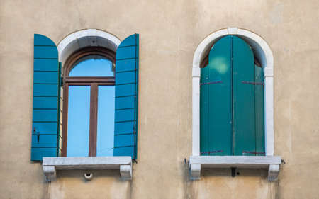 Old vintage windows in Venice, Italy.