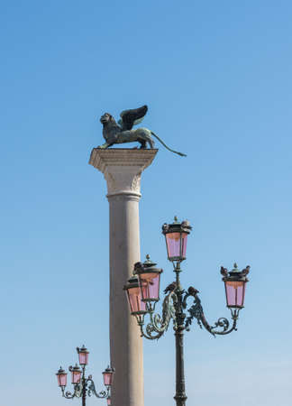 Street lamps and column with winged lion in the St. Mark's Square (Piazza San Marco), in Venice, Italy