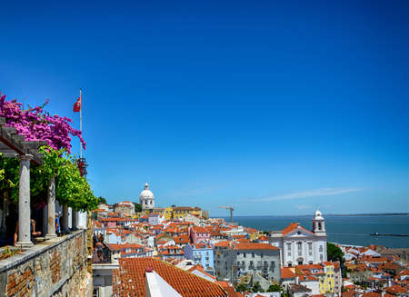 Beautiful panoramic view from Santa Luzia viewpoint (miradouro) to Alfama old town, with Santa Estevao Church, National Pantheon (Santa Engracia Church) and Tagus river, in Lisbon, Portugal. 免版税图像