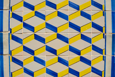 """Ornamental old typical tiles from Portugal called """"azulejos"""" made with colored ceramic tiles, who decorates the houses in Lisbon, Portugal Zdjęcie Seryjne"""
