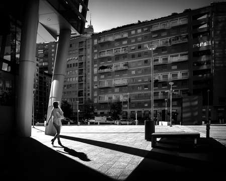 Milan/Italy- July 14, 2016: people walking in new Porta Nuova business district, morning light