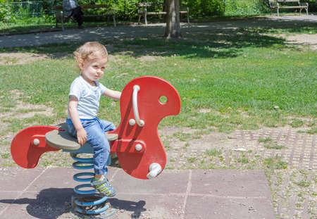 Cute little child and his mother playing in the park 免版税图像