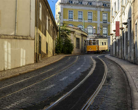 Vintage yellow tram in the city center of Lisbon, Portugal.