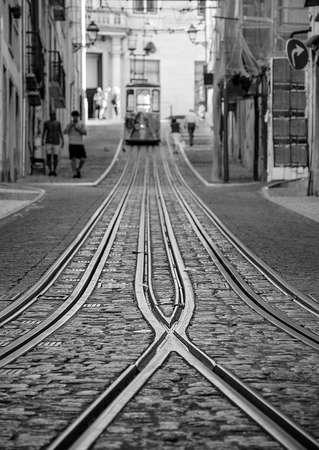 Famous Bica Funicular (Elevador da Bica or Ascensor da Bica), the third oldest of all, inaugurated in 1892, in district of Baixa-Chiado, Lisbon, Portugal. Selective focus on the rails.