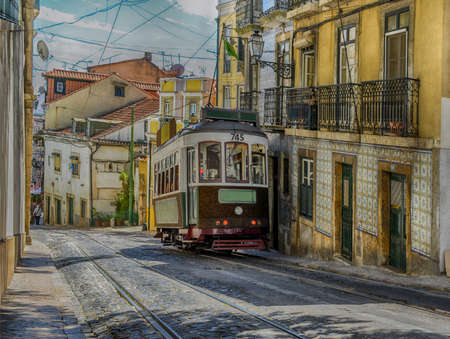 Vintage yellow tram in the city center of Lisbon, Portugal