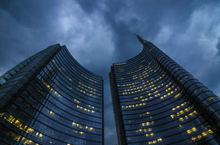 Milan/Italy- July 12, 2016: modern building of Unicredit tower in new Porta Nuova business district, the tallest skyscraper in Italy, by night 新闻类图片