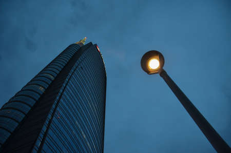Milan/Italy- July 13, 2016: modern building of Unicredit tower in new Porta Nuova business district, the tallest skyscraper in Italy, by night 新闻类图片