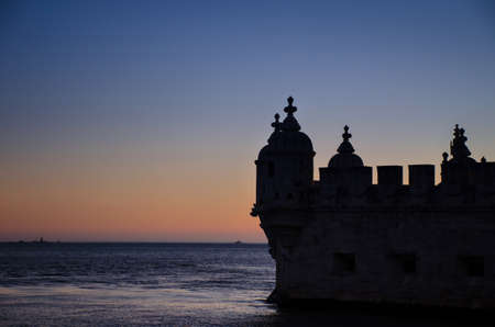 Belem tower, famous tourist attraction in Lisbon, Portugal, at sunset