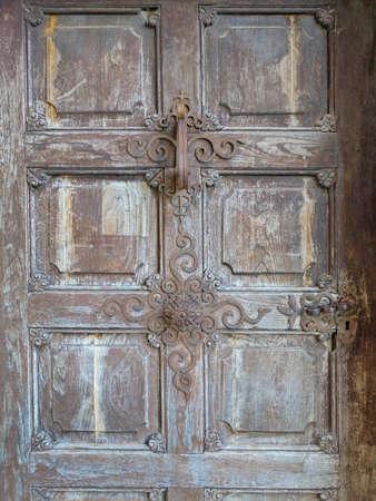 Old wooden door of the pilgrimage Church Maria Strassengel, a 14th century Gothic church in the town Judendorf Strassengel near Graz, Styria region, Austria