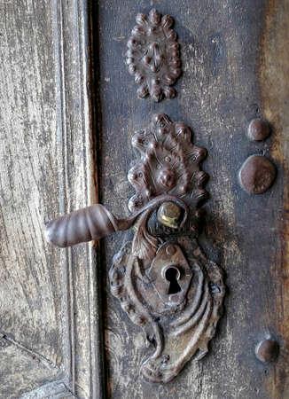Detail of a beautiful old wooden door of Church Maria Strassengel, a 14th century Gothic pilgrimage church in the town of Judendorf Strassengel near Graz, Styria region, Austria