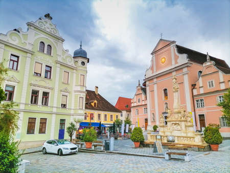 The main square with old buildings and Parish Church in the charming little town of Frohnleiten in the district of Graz-Umgebung, Styria region, Austria