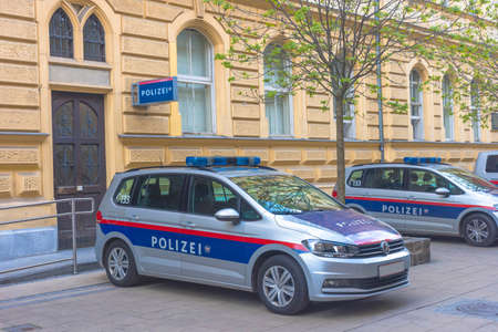 Austrian federal police cars parked on the street in front of the police headquarters in the old city center of Graz, Austria Éditoriale
