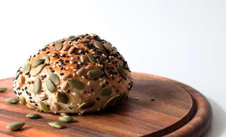multi grain: Multi grain bun on white background Stock Photo