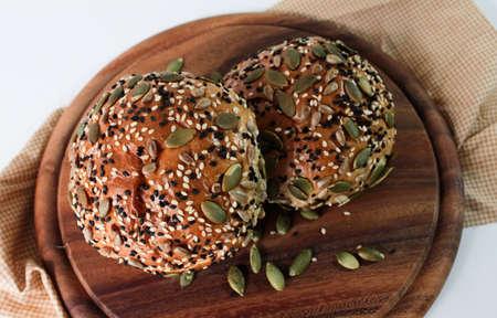 multi grain: Multi grain bun on wooden tray