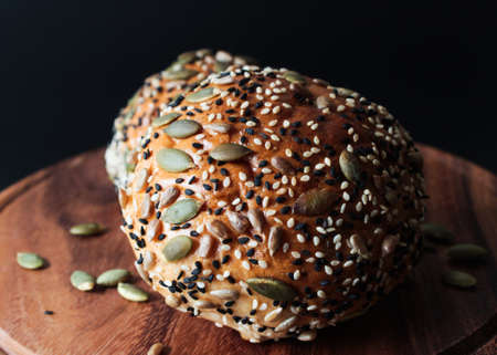 multi grain: Multi grain bun on black background Stock Photo