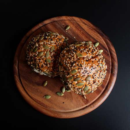 Multi grain bun on black background Stock Photo