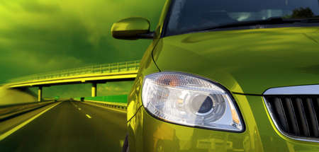 dealer: Green car on the road Stock Photo